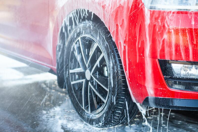 Red Car going through Car Wash
